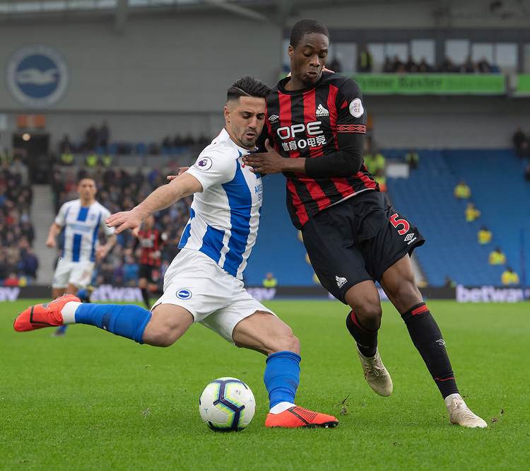 Huddersfield Town's Terence Kongolo (right) battles with Brighton & Hove Albion's Beram Kayal (left) <br /> <br /> Photographer David Horton/CameraSport<br /> <br /> The Premier League - Brighton and Hove Albion v Huddersfield Town - Saturday 2nd March 2019 - The Amex Stadium - Brighton<br /> <br /> World Copyright © 2019 CameraSport. All rights reserved. 43 Linden Ave. Countesthorpe. Leicester. England. LE8 5PG - Tel: +44 (0) 116 277 4147 - admin@camerasport.com - www.camerasport.com