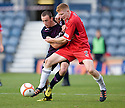 Partick's Stuart Bannigan and Raith's Jason Thomson challenge for the ball ...