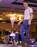Dave Holman walks the runway during the Nevada Humane Society's 3rd  annual Heels & Hounds event at the Atlantis Resort and Spa in Reno on April 9, 2017.