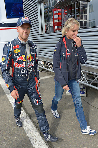 01.09.2012. Spa, Belgium.  German Formula One driver Sebastian Vettel of Red Bull (l) and his press officer Britta Roeske walk through the paddock during the qualification session at the race track Circuit de Spa-Francorchamps near Spa, Belgium, 01 September 2012. The Formula One Grand Prix of Belgium will take place on 02 September 2012.