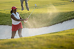 STILLWATER, OK -  Lakareber Abe of Alabama chips onto the 18th green from a bunker during the Division I Women's Golf Team Match Play Championship held at the Karsten Creek Golf Club on May 23, 2018 in Stillwater, Oklahoma. (Photo by Shane Bevel/NCAA Photos via Getty Images)