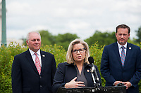 House GOP Conference Chairwoman Liz Cheney (R-WY) offers remarks as she is joined by House Minority Leader Rep. Kevin McCarthy (R-Calif., left), House Minority Whip Rep. Steve Scalise (R-LA) and others to announce that Republican leaders have filed a lawsuit against House Speaker Nancy Pelosi and congressional officials in an effort to block the House of Representatives from using a proxy voting system to allow for remote voting during the coronavirus pandemic, outside of the U.S. Capitol in Washington, DC., Wednesday, May 27, 2020. Credit: Rod Lamkey / CNP/AdMedia