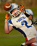 A high school player bobbles a pass before coming up with the reception.