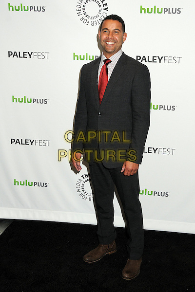 "Jon Huertas.PaleyFest 2012 Presents ""Castle"" held at The Saban Theatre, Beverly Hills, California, USA, 9th March 2012..full length grey gray suit red tie smiling  striped shirt .CAP/ADM/BP.©Byron Purvis/AdMedia/Capital Pictures."