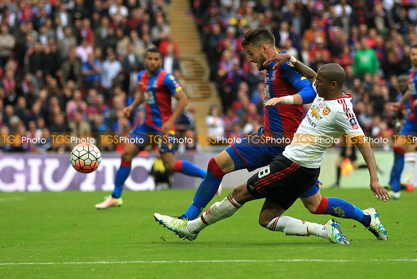 Ashley Young of Manchester United cross under pressure from Joel Ward of Crystal Palace during Crystal Palace vs Manchester United, Emirates FA Cup Final Football at Wembley Stadium on 21st May 2016