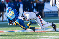 Annapolis, MD - DEC 28, 2017: Navy Midshipmen running back Darryl Bonner (29) is tackled by Virginia Cavaliers safety Juan Thornhill (21) during game between Virginia and Navy at the Military Bowl presented by Northrop Grunman at Navy-Marine Corps Memorial Stadium Annapolis, MD. (Photo by Phil Peters/Media Images International)