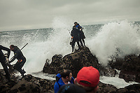 December 20, 2011 - Laxe (La Coruña). A group of percebeiros gets hit by an unexpected wave. Even when the weather is good, the sea is extremely dangerous in this part of the coast. © Thomas Cristofoletti 2011