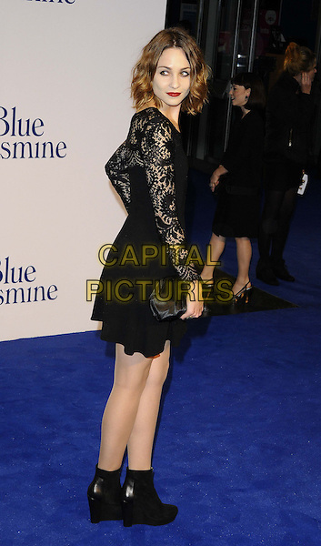 Tuppence Middleton<br /> The &quot;Blue Jasmine&quot; UK film premiere, Odeon West End cinema, Leicester Square, London, England.<br /> September 17th, 2013<br /> full length black dress lace clutch bag ankle boots side looking over shoulder <br /> CAP/CAN<br /> &copy;Can Nguyen/Capital Pictures