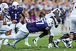 TCU Horned Frogs defensive tackle Chris Bradley (97) and Samford Bulldogs running back Denzel Williams (25) in action during the game between the Samford Bulldogs and the TCU Horned Frogs at the Amon G. Carter Stadium in Fort Worth, Texas.  TCU leads Stamford 24 to 7 at halftime.