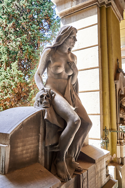 Picture and image of the stone sculpture of a nude on the Taramiso tomb. The  monumental tombs of the Staglieno Monumental Cemetery, Genoa, Italy