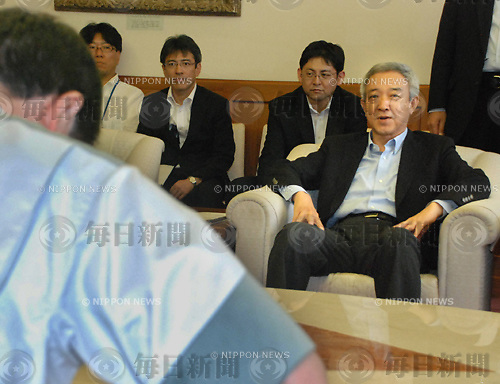 July 3, 2011. Ryu Matsumoto (R), a former ministory of Recovery and Reconstruction, visiting Miyagi prefactual government. Yoshihiro Murai  (L), Miyagiwate prefectural governor, giving him a  demanding paper.
