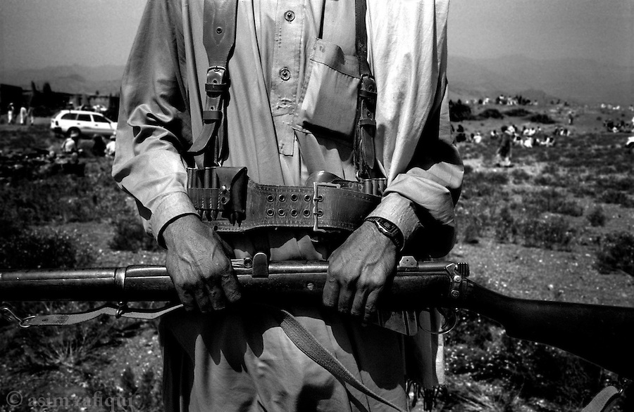 barwaiz raghzai hills, south waziristan, april 2004: a member of the tribal lashkar called by the ahmedzai tribe<br />