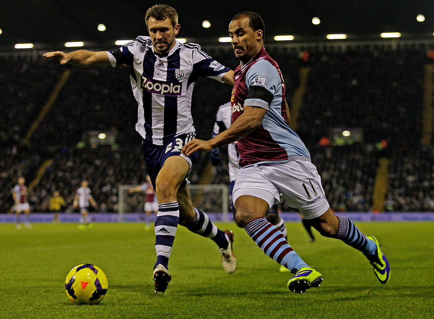 Aston Villa's Gabriel Agbonlahor in action against West Bromwich Albion's Gareth McAuley.<br /> <br /> Photo by James Marsh/CameraSport<br /> <br /> Football - Barclays Premiership - West Bromwich Albion v Aston Villa - Monday 25th November 2013 - The Hawthorns - West Bromwich<br /> <br /> &copy; CameraSport - 43 Linden Ave. Countesthorpe. Leicester. England. LE8 5PG - Tel: +44 (0) 116 277 4147 - admin@camerasport.com - www.camerasport.com