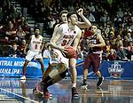 SIOUX FALLS, SD - MARCH 22: Zach Hankins #35 from Ferris State eyes the basket after getting a step past Ryan Quaid #22 from West Texas A&M during their semifinal game at the 2018 Elite Eight Men's NCAA DII Basketball Championship at the Sanford Pentagon in Sioux Falls, SD. (Photo by Dave Eggen/Inertia)
