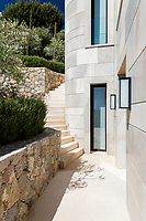 A curving stone staircase links the different levels of the outside area of the villa.