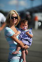Aug. 7, 2009; Watkins Glen, NY, USA; Crystal Hornish and daughter Addison on pit road as husband NASCAR Sprint Cup Series driver Sam Hornish Jr (not pictured) runs during qualifying for the Heluva Good at the Glen. Mandatory Credit: Mark J. Rebilas-