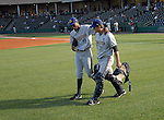 Charleston RiverDogs pitcher Jairo Heredia (18), left, puts his arm around catcher J.R Murphy (21) as they head to the bullpen for warmups prior to a game on May 27, 2010, at Fluor Field at the West End in Greenville, S.C.