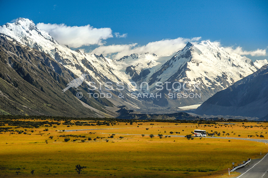 Tourist bus on the spectacular road to Aoraki Mt Cook village, near the airport. Canterbury New Zealand.