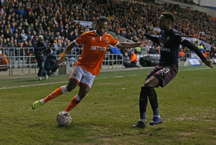 Blackpool's Nathan Delfouneso is tackled by Arsenal's Joe Willock<br /> <br /> Photographer Stephen White/CameraSport<br /> <br /> Emirates FA Cup Third Round - Blackpool v Arsenal - Saturday 5th January 2019 - Bloomfield Road - Blackpool<br />  <br /> World Copyright &copy; 2019 CameraSport. All rights reserved. 43 Linden Ave. Countesthorpe. Leicester. England. LE8 5PG - Tel: +44 (0) 116 277 4147 - admin@camerasport.com - www.camerasport.com