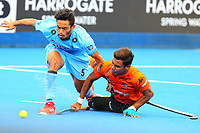 India's Kothajit Khadangbam and Malaysia's Izad Jamaluddin compete for the ball during the Hockey World League Quarter-Final match between India and Malaysia at the Olympic Park, London, England on 22 June 2017. Photo by Steve McCarthy.