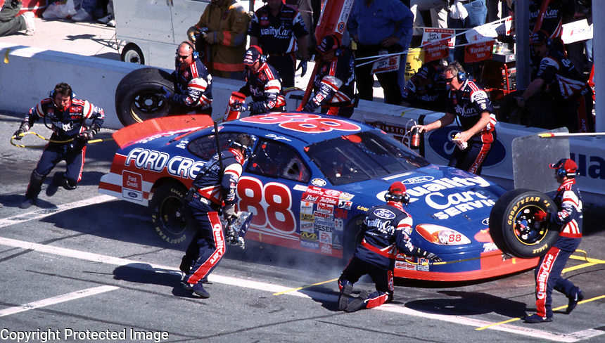 NASCAR driver Dale Jarrett slides to a stop in his pit stall as his crew goes to work during a pit stop in the 2000 Daytona 500 at Daytna International Speedway 2/20/00.  Jarrett won the race, taking his third career victory in the event.(Photo by Brian Cleary)