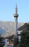 Minaret of the Mosque, part of Memi Pasha's original 17th century plan for the Bazaar, destroyed by fire and rebuilt c. 1757, Gjirokastra, Southern Albania. Gjirokastra was settled by the Greek Chaonians, the Romans and Byzantines before becoming an Ottoman city in 1417. Its old town was listed as a UNESCO World Heritage Site in 2005. Picture by Manuel Cohen
