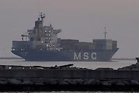 - container ship leaves the port ....- nave portacontainer lascia il porto