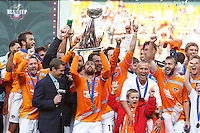 Houston Dynamo defender (24) Wade Barrett hoists the Alan I. Rothenberg Trophy during the post-game celebrations. The Houston Dynamo defeated the New England Revolution 2-1 in the finals of the MLS Cup at RFK Memorial Stadium in Washington, D. C., on November 18, 2007.