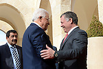 Jordanian King Abdullah II, right, greats Palestinian President Mahmoud Abbas in Amman, Jordan, Wednesday, Nov. 12, 2014. Abbas' adviser Nabil Abu Rdeneh said Abbas was also scheduled to meet U.S. Secretary of State John Kerry in the Jordanian capital on Thursday, and would emphasize his concerns about alleged Israeli attempts to change the status quo at the Jerusalem holy site, known to Jews as the Temple Mount and to Muslims as the Noble Sanctuary. Photo by Thaer Ganaim