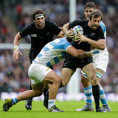 20.09.2015. London, England. Rugby World Cup. New Zealand versus Argentina.  New Zealand centre Conrad Smith tries to burst through a tackle