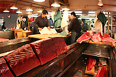 Mar 4, 2006; Tokyo, JPN; Tsukiji.Raw tuna is cut into different size filets before being sold at the Tsukiji Fish Market...Photo credit: Darrell Miho