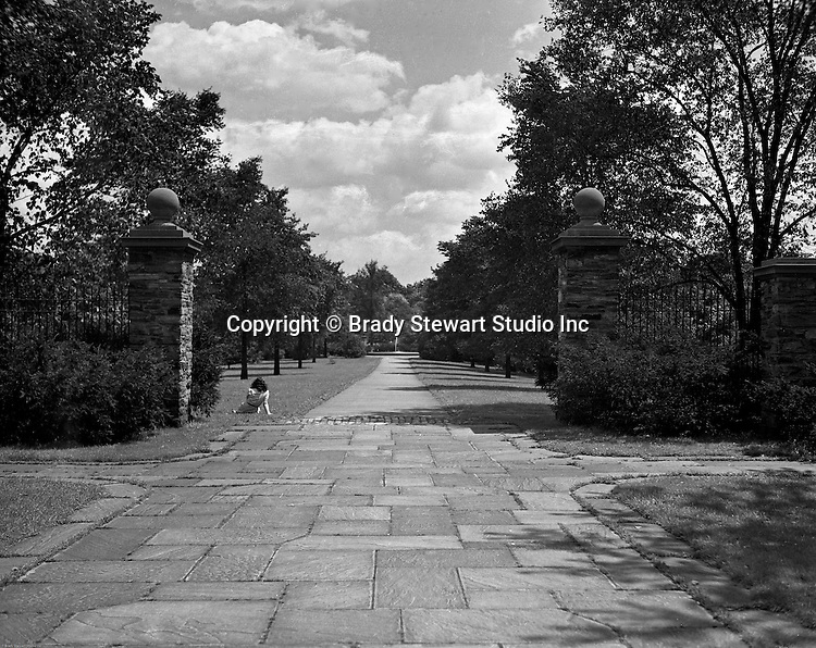 Pittsburgh PA:  One of the entrances to Frick Park - 1952.  John Russell Pope designed the park's distinctive gatehouse entrance structures from 1931-1935. The park was created after a gift was made to the city of Pittsburgh by Henry Clay Frick.  When he died in 1919, Frick bequeathed to the city 151 acres south of his Point Breeze mansion, Clayton, and provided a $2 million trust fund to help create the park and assist with its long-term maintenance. The city began moving in earnest to create the park in 1925, when it acquired 190 additional acres, presumably with the goal to create a park of similar size and scope to Schenley and Highland Parks. The park officially opened in 1927.