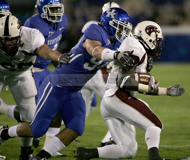 Defensive end, Tyler Wyndham tackles the Warhawks running back, Frank Goodin in the first half. The UK football team plays Louisiana-Monroe at Commonwealth Stadium on Saturday, Oct. 24, 2009. Photo by Adam Wolffbrandt | Staff
