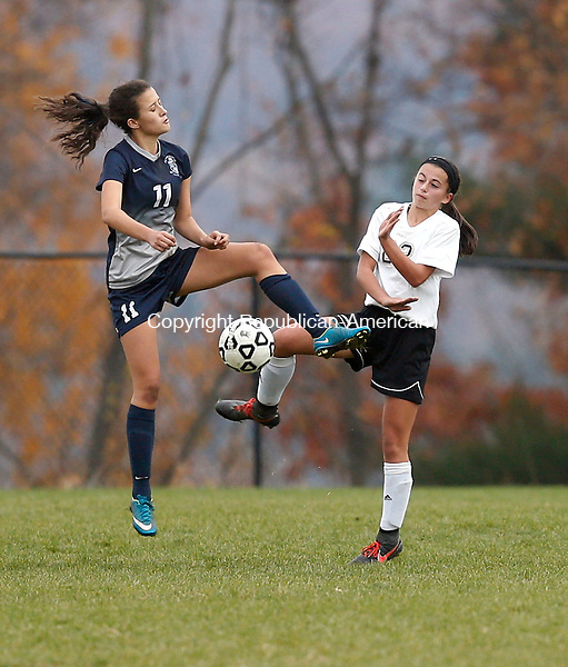Beacon Falls, CT- 09 November 2016-110916CM01- Immaculate's Kayla Mingachos left, and Woodland's Megen Sirowich go in for the ball during their state tournament matchup in Beacon Falls on Wednesday.  Woodland would be knocked out of the tournament, after losing 2-1.     Christopher Massa Republican-American