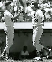 "Oakland A's ""bash brothers"" Mark McGuire greets Jose Canseco after HR.( photo Ron Riesterer)"