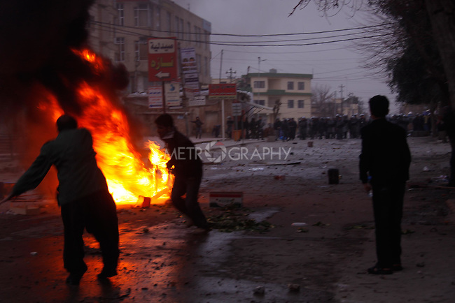 SULAIMANIYAH, IRAQ: Protesters throw rocks at the police...A third day of violence rocks the Iraqi Kurdish city of Sulaimaniyah.  Tensions between protesters and security forces flare after the security forces continue to use life ammunition during the demonstrations...Photo by Ali Arcady