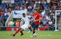 Sander Berge (Valerenga) of Norway & Marcus Rashford (Manchester United) of England in action during the International EURO U21 QUALIFYING - GROUP 9 match between England U21 and Norway U21 at the Weston Homes Community Stadium, Colchester, England on 6 September 2016. Photo by Andy Rowland / PRiME Media Images.