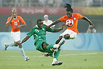 07 August 2008: Olubayo Adefemi (NGA) (13) and Royston Drenthe (NED) (15) challenge for the ball.  The men's Olympic team of the Netherlands played the men's Olympic soccer team of Nigeria at Tianjin Olympic Center Stadium in Tianjin, China in a Group B round-robin match in the Men's Olympic Football competition.