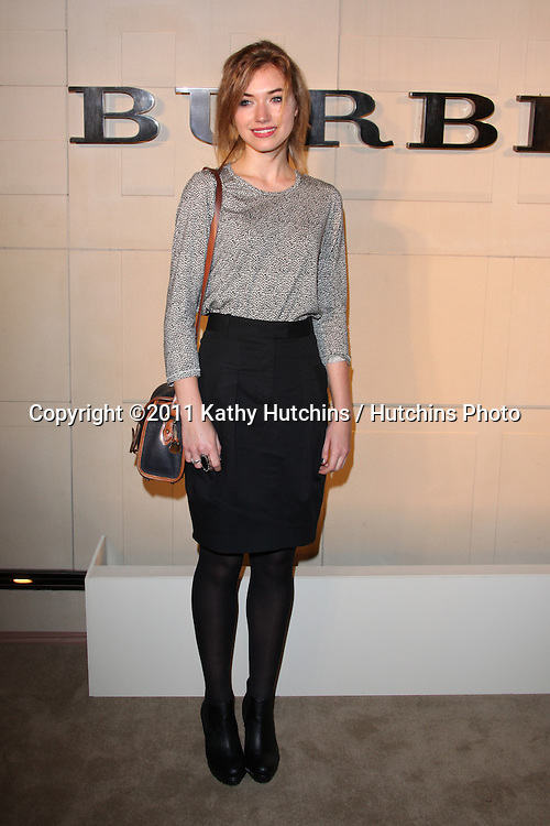 LOS ANGELES - OCT 26:  Imogen Poots  arriving at the Burberry Body Launch at Burberry on October 26, 2011 in Beverly Hills, CA