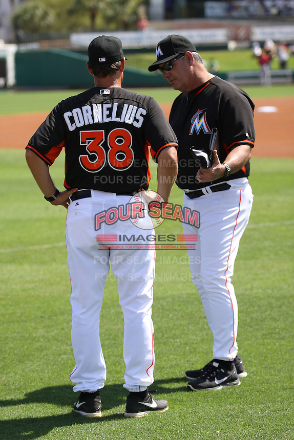 Reid Cornelius (38) and Chuck Hernandez (55) of the Miami Marlins confer with each other before a Grapefruit League Spring Training game at the Roger Dean Complex on March 4, 2014 in Jupiter, Florida. Miami defeated Minnesota 3-1. (Stacy Jo Grant/Four Seam Images)