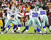 Dallas Cowboys quarterback Tony Romo (9) hands the ball to running back Felix Jones (28) in fourth quarter action against the Washington Redskins at FedEx Field in Landover, Maryland on Sunday, December 30, 2012.  The Redskins won the game 28 - 18 to capture the NFC East title..Credit: Ron Sachs / CNP.(RESTRICTION: NO New York or New Jersey Newspapers or newspapers within a 75 mile radius of New York City)