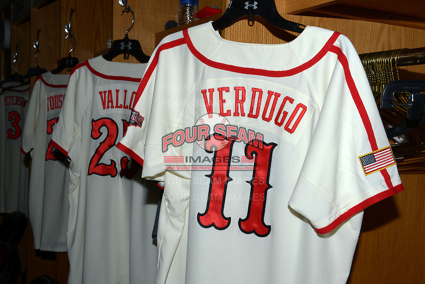 Jerseys for Alex Verdugo (11) and Chase Vallot (25) hang in the locker room before the Under Armour All-American Game on August 24, 2013 at Wrigley Field in Chicago, Illinois.  (Mike Janes/Four Seam Images)