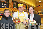 Eileen O'Sullivan, James Brosnan and Margaret Ryan with some of the Christmas cakes at the Garvey's Super Valu Castleisland food fair on Friday