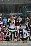 July 31st, 2011- Tokyo, Japan- Maid cosplayers preparing water for sprinkling: This summer, Japan is concerned for saving electricity due to the Fukushima nuclear plant disaster. Maids cos-players are doing water sprinkling to make the temperature cooler in Akihabara, Japan.(Photo by Yumeto Yamazaki/AFLO)