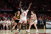 COLLEGE PARK, MD - FEBRUARY 13: Kaila Charles #5 and Taylor Mikesell #11 of Maryland block McKenna Warnock #14 of Iowa during a game between Iowa and Maryland at Xfinity Center on February 13, 2020 in College Park, Maryland.