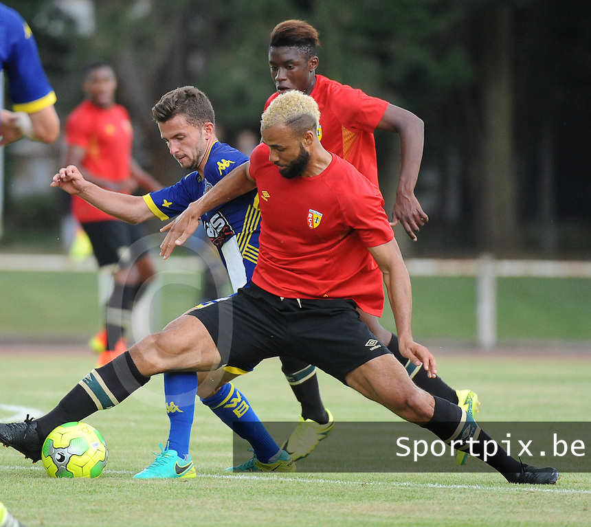 20160713 - DOUAI , FRANCE : RC Lens' John Bostock (R) and Waasland Beveren's Siebe Schrijvers (L) pictured during a friendly game between Racing Club de LENS and Waasland Beveren during the preparations for the 2016-2017 season , Wednesday 13 July 2016 ,  PHOTO Dirk Vuylsteke | Sportpix.Be