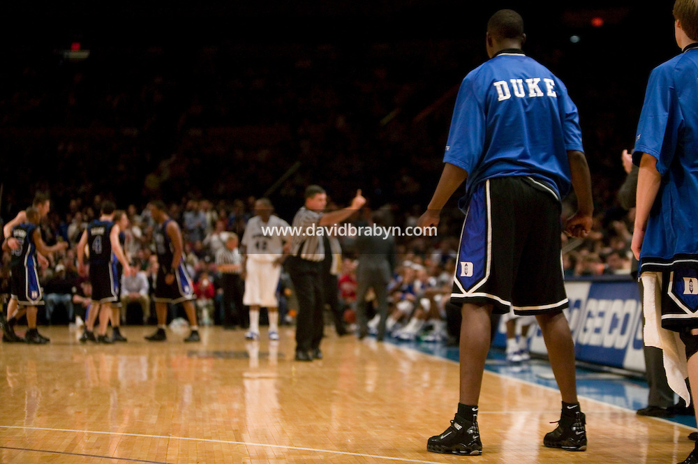 Eric Boateng (2R) watches his teammates from the Duke university sideline during a pre-season college game at the Madison Square Garden in New York City, United States, 25 November 2005.