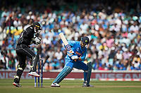 Tom Blundell (New Zealand) takes as MS Dhoni (India) leaves during India vs New Zealand, ICC World Cup Warm-Up Match Cricket at the Kia Oval on 25th May 2019