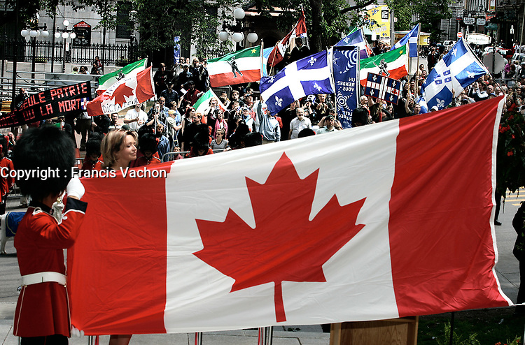 """Quebec City, July 1, 2007 ? Protesters take part into the annual MLNQ (Mouvement de liberation National du QuÈbec) Canada Day protest while Conservative Minister JosÈe Verner proceed with the raising of the flag ceremony in front of the Quebec City hall July 1, 2007. Each year, the MLNQ gather a couple of dozens of hard line separatists to protest the """"Canadian colonialism demonstration of Canada Day"""".<br /> <br /> PHOTO :  Francis Vachon - Agence Quebec Presse"""
