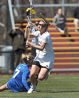 Boston College midfielder Kate McCarthy (20) on the attack eludes Duke University midfielder Chelsea Landon (7).Boston College (white) defeated Duke University, 10-9, at Newton Campus Lacrosse Field, on April 6, 2013.